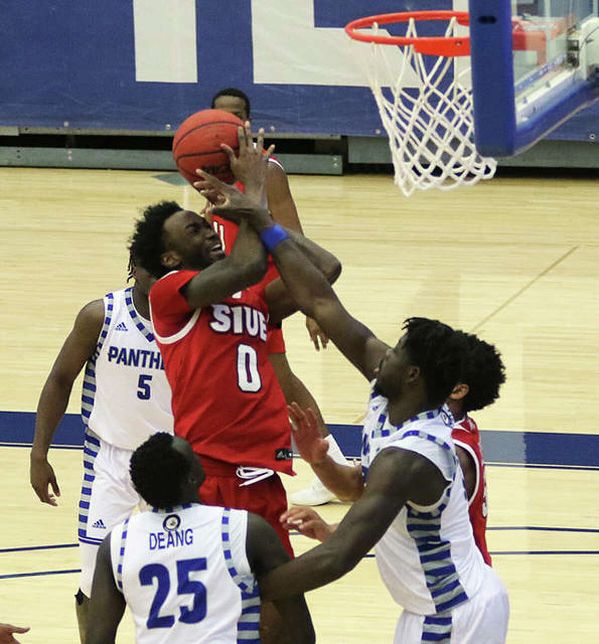 SIUE's Sidney Wilson (0) gets raked on the arm by Eastern Illinois' Madani Diarra (right) but gets no foul call in the lane during the second half Tuesday night at Lantz Arena in Charleston.