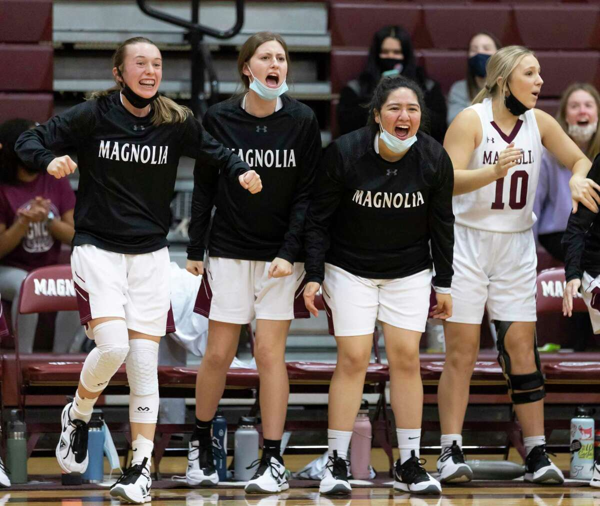 FILE PHOTO - Magnolia High School girls basketball team players react after their team ties 46-46 during the fourth quarter of a District 19-5A girls basketball game against Bryan Rudder at Magnolia High School, Tuesday, Jan 12, 2021, in Magnolia.
