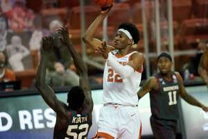 Texas forward Kai Jones (22) shoots against Oklahoma during the second half of an NCAA college basketball game, Tuesday, Jan. 26, 2021, in Austin, Texas. (AP Photo/Eric Gay)