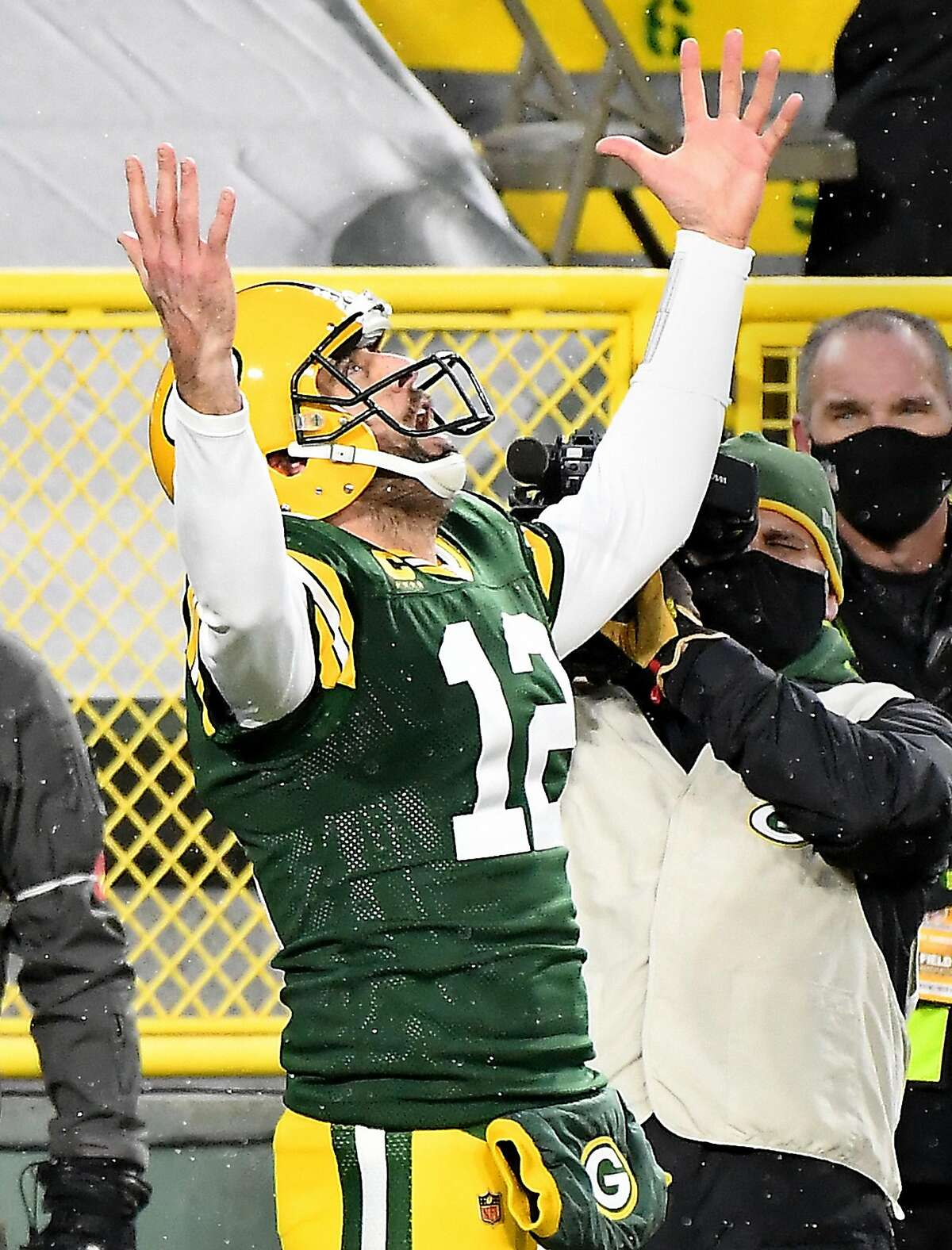 Green Bay Packers quarterback Aaron Rodgers (12) looks to the sky after scoring on a 1-yard touchdown run against the Los Angeles Rams in the second quarter during an NFC Divisional playoff game at Lambeau Field in Green Bay, Wisconsin, on Saturday, Jan. 16, 2021. (Wally Skalij/Los Angeles Times/TNS)
