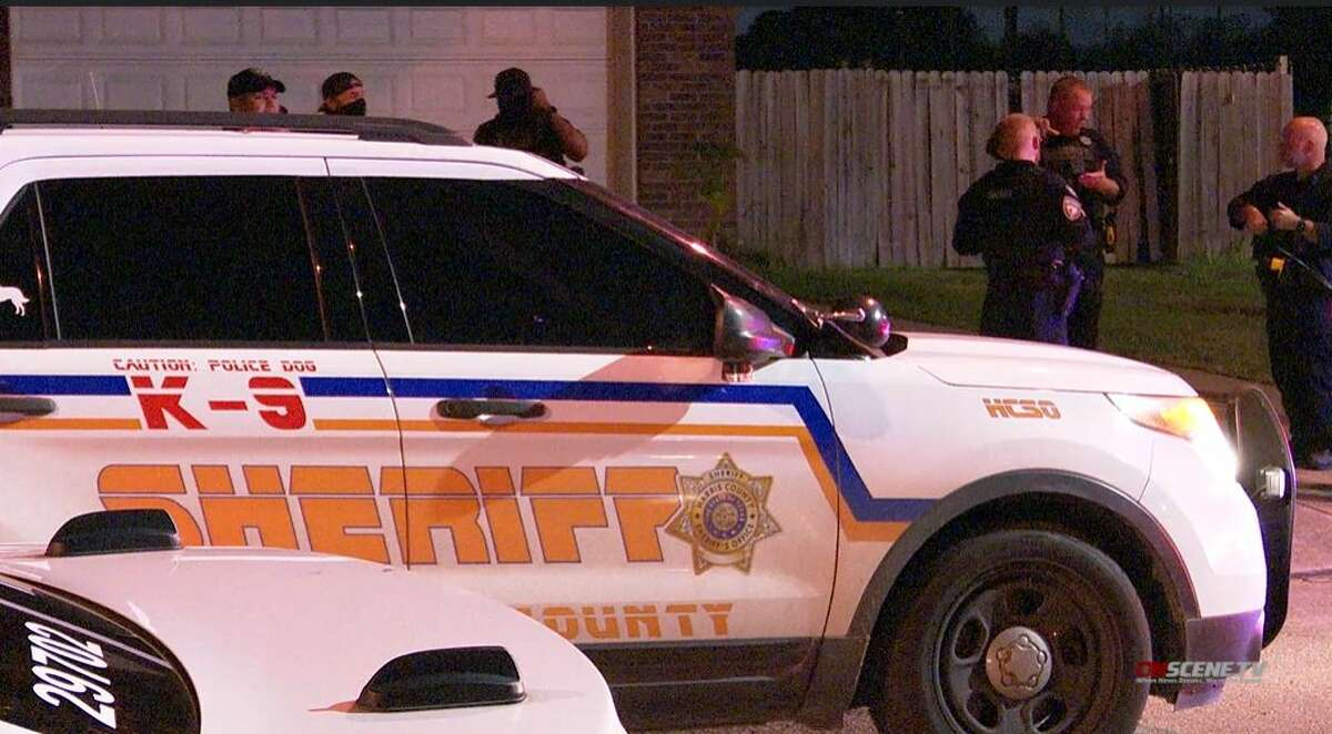 Authorities investigate the scene where a shooting suspect was taken into custody Tuesday night in northwest Harris County.
