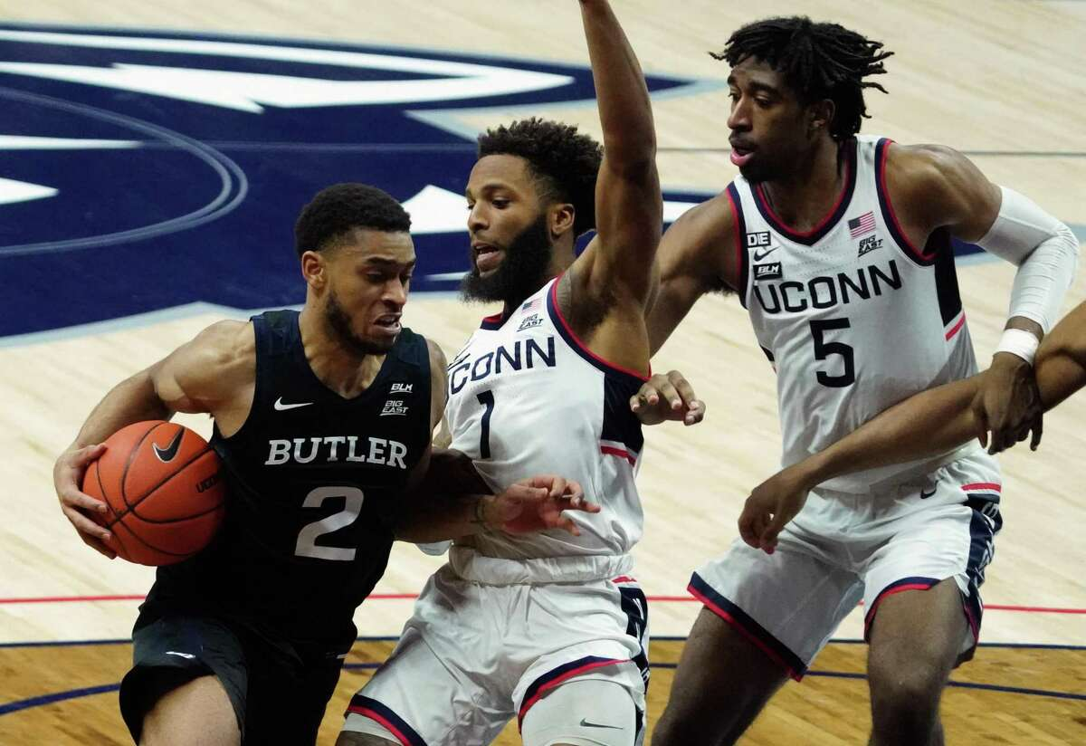 Jan 26, 2021; Storrs, Connecticut, USA; Butler Bulldogs guard Aaron Thompson (2) drives the ball against Connecticut Huskies guard R.J. Cole (1) and forward Isaiah Whaley (5) in the second half at Harry A. Gampel Pavilion. Mandatory Credit: David Butler II-USA TODAY Sports