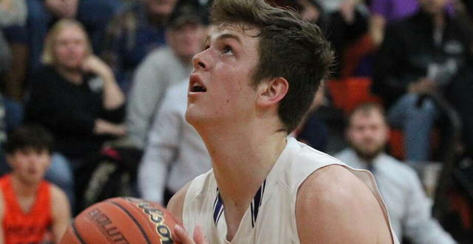 Routt's Gus Abell looks up at the basket in a game at last season's Franklin Regional. Photo: Dennis Mathes | Journal-Courier File