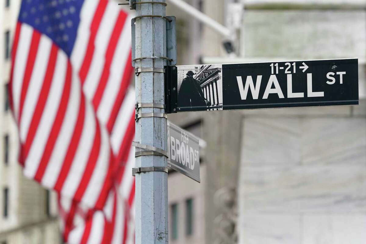 FILE - A street sign is displayed at the New York Stock Exchange in New York, Monday, Nov. 23, 2020.