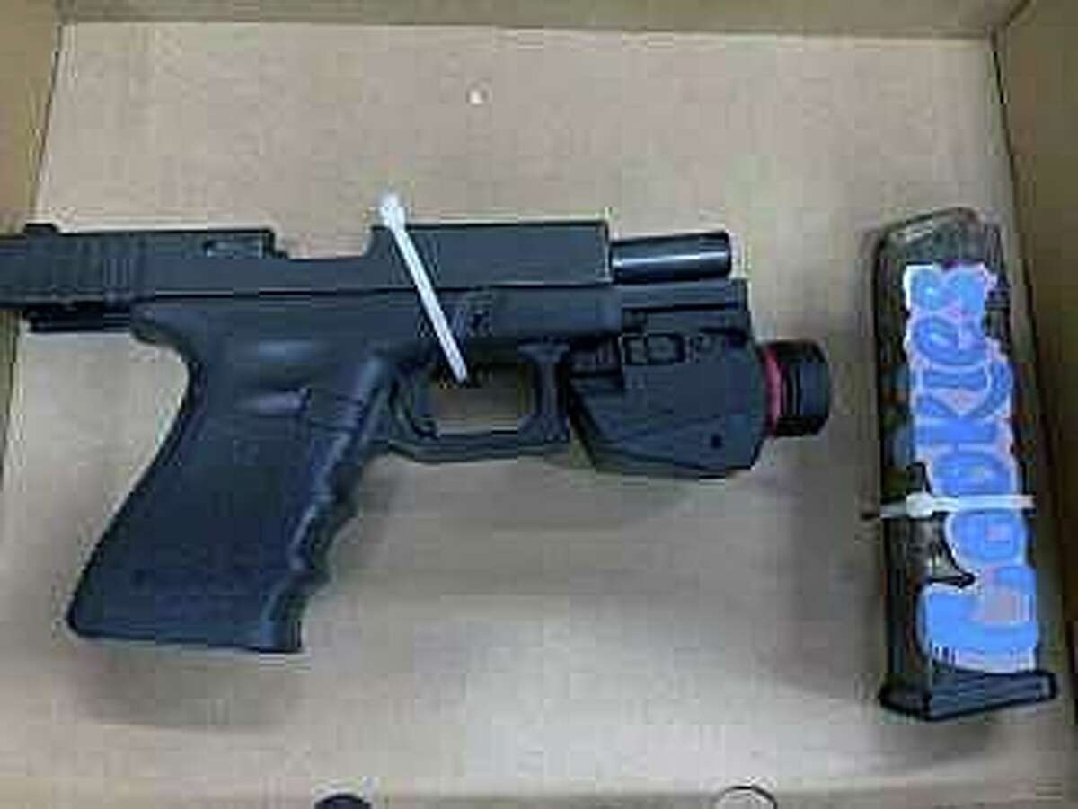 A gun seized during an arrest in Meriden, Conn., on Tuesday, Jan. 26, 2021.