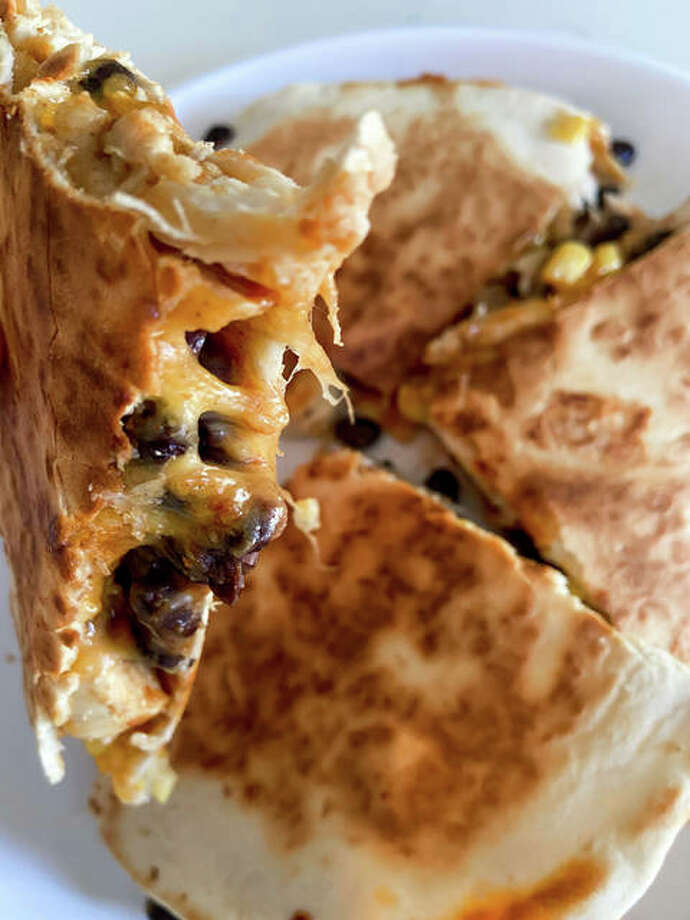 Loaded chicken quesadillas are sautéed in taco seasoning and are filled with black beans, corn, gooey cheese and toasted tortillas. Photo: Courtesy Rachel Tritsch