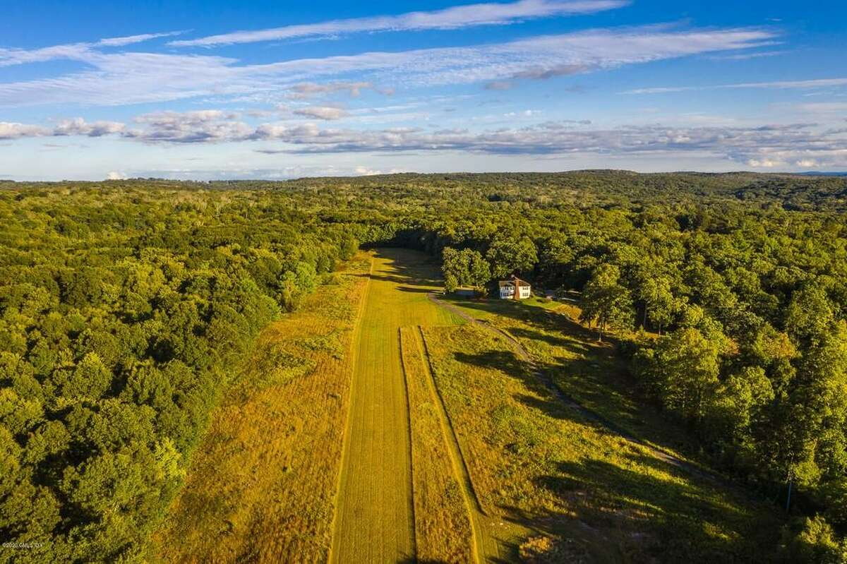 The house at 96 Romford Road in Washington Depot, Conn. is on the market for $5,750,000. The property comes with a helipad and landing strip. The property also features flowering trees and