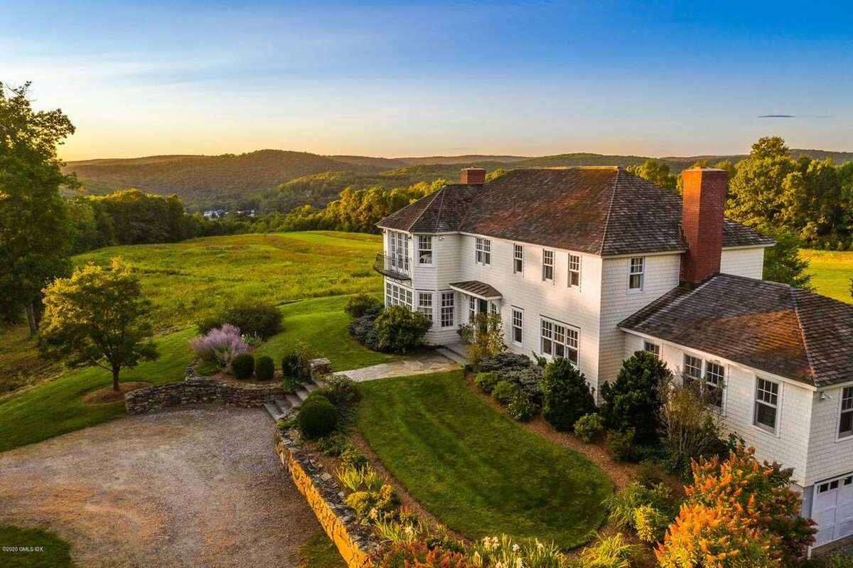 """The house at 96 Romford Road in Washington Depot, Conn. is on the market for $5,750,000. The property comes with a helipad and landing strip. """"We've had the pleasure and privilege of accessing so many wonderful aspects of New England with use of the airport,"""" said Jodi Brown, the current owner. """"On a beautiful Sunday, an owner of this home can spontaneously pack a beach bag and cooler and be enjoying beaches on Nantucket or Martha's Vineyard."""""""