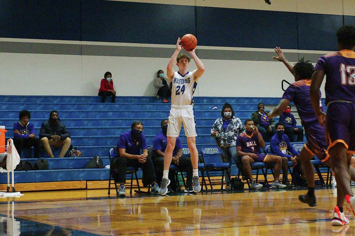 Friendswood's Luke Lipetska (24) launches a shot against Galveston Ball Tuesday in a District 22-5A basketball game at Friendswood High School.
