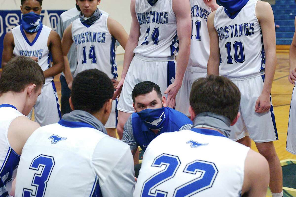 Friendswood basketball coach Caleb Marburger speaks to his team during a break against Galveston Ball Tuesday in a District 22-5A game at Friendswood High School.