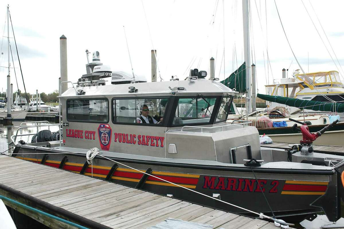 League City Assistant Fire Marshal Jeff Allen is seated in the League City Fire Department's all-hazard response boat, which is docked at South Shore Harbor. The $436,790 cost for the craft was mostly covered through a Department of Homeland Security grant.