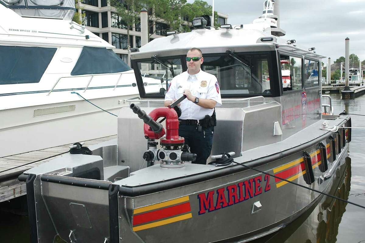Allen shows the boat's water cannon.