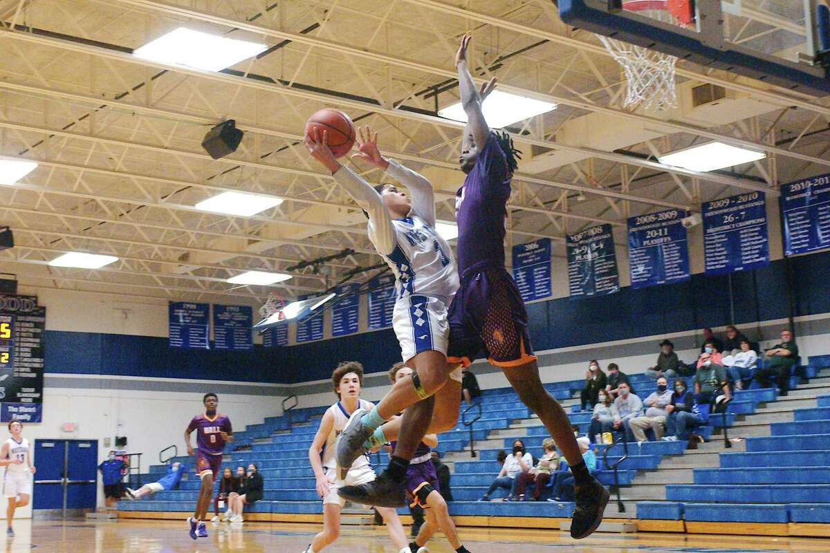 Friendswood's Troy Barnes (3) tries to maneuver around Galveston Ball's Josh Blanks (3) Tuesday at Friendswood High School.