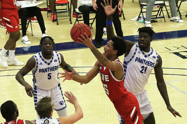 SIUE's Lamar Wright puts up a shot between three Eastern Illinois defenders during Tuesday's Ohio Valley Conference game inside Lantz Arena in Charleston.