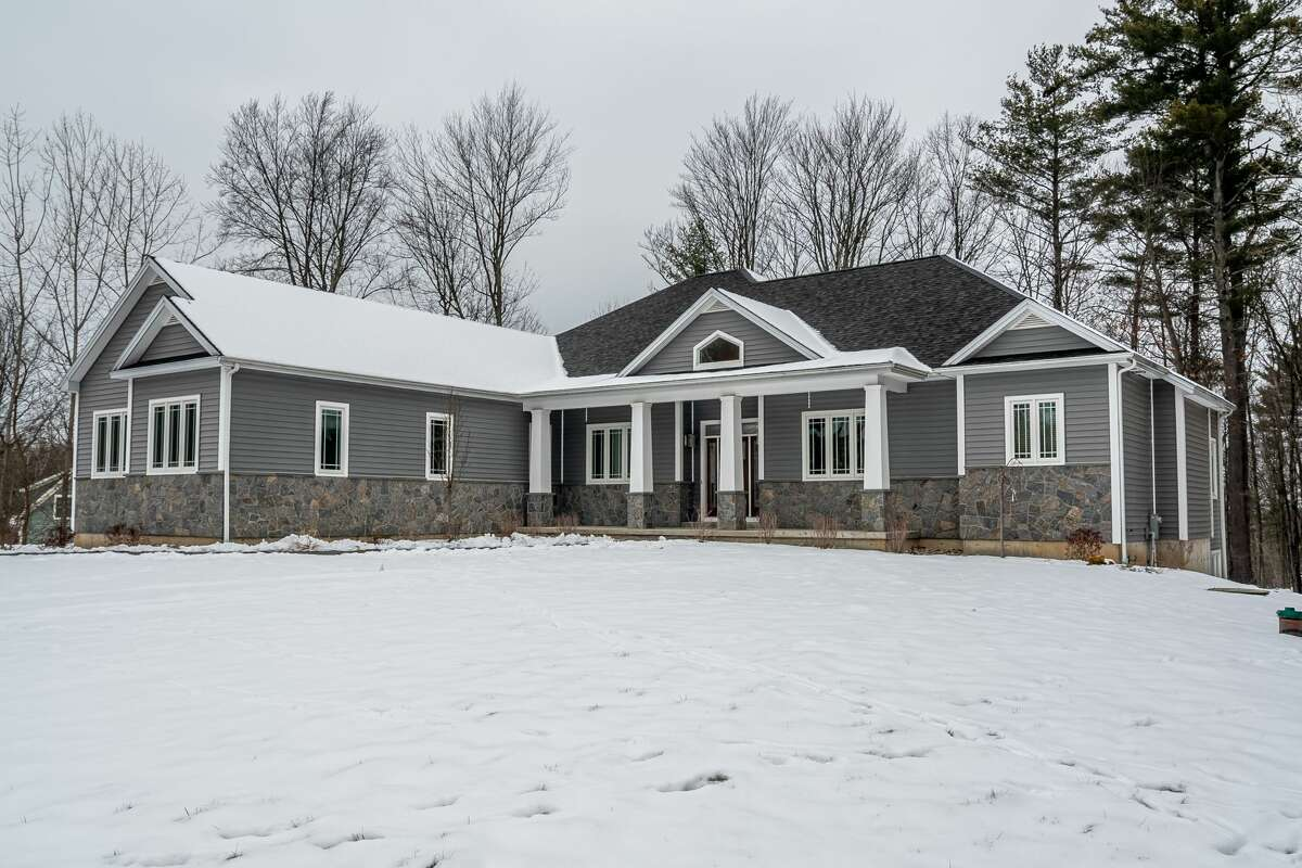 A ranch-style home at 109 Trask Lane built in 2010 off Neilson Road in the town of Saratoga (Stillwater address). It has 3,280 square feet of living space, three bedrooms, two and a half bathrooms, and a three-car garage and a saltwater pool on just less than an acre lot. Open layout, cherry floors, double-sided fireplace. Stillwater schools. Taxes: $10,883. List price: $699,900. Contact listing agent Haleh Struzinsky, broker/owner of HS Capital Realty at 518-729-8278. https://realestate.timesunion.com/listings/109-Trask-La-Stillwater-NY-12170-MLS-202110846/48428667