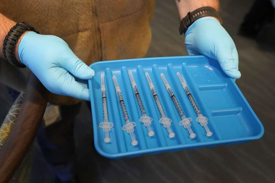 Syringes containing the COVID-19 vaccine are shown Wednesday, Jan. 6, 2021, at John Knox Village in Pompano Beach, Fla. Photo: Wilfredo Lee, Associated Press