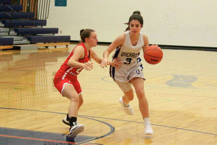 Sara Bromley drives to the lane for the Portagers. (News Advocate file photo)