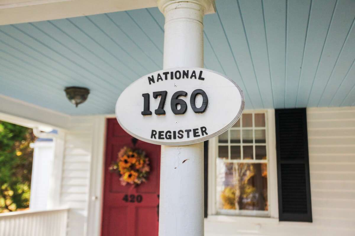"""The colonial farmhouse at 420 Tashua Road, Trumbull is on the National Register of Historic Places. This house was originally built on a 500-acre estate that was purchased from a Native American tribe """"for five gallons of whiskey and a stove pipe hat,"""" he said. Long before the recent resurgence of interest in purchasing historic homes, Kenneth and Elaine Hyland were attracted to this center-chimney house while on a drive. """"We saw the farmhouse and had to have it,"""" Kenneth Hyland said. That was 42 years ago. Elaine Hyland said she knew she had to live in this house the minute she crossed the threshold. """"This is the kind of house you buy with your heart, not your head,"""" she said. """"It's not open concept but it's cozy ... It's not a money pit,"""" she said."""