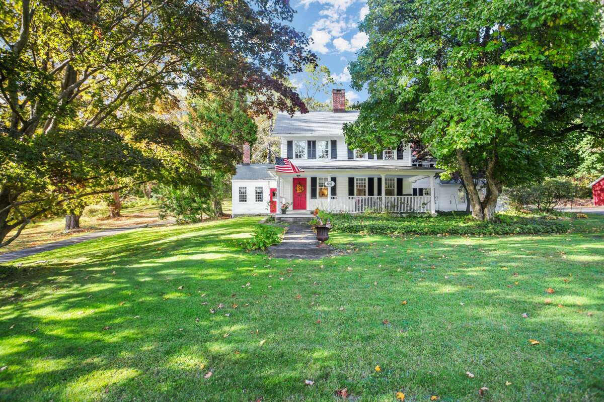 """The David Mallett Jr. House at 420 Tashua Road, Trumbull was built in 1760. The David Mallett Jr. House was built in 1760 before the birth of the United States and the Revolutionary War. It sits on a 1.51-acre level lot across the street from Christ Episcopal Church and Tashua Burial Ground. All three properties (the house, church and cemetery) are on the National Register of Historic Places. According to Sara Fowler, one of the two listing agents, it's the only home in Trumbull recognized by the National Register of Historic Places. Lois Levine, president emeritus of the Trumbull Historical Society, confirms there was a murder at the house in 1908. The daughter of the owner was killed by the hired man when she rebuffed his suggestion of marriage. Hers may be among the spirits that inhabit the house. """"There's a sense that there's something here. There are ghosts, but they're good ghosts,"""" current owner Kenneth Hyland said."""