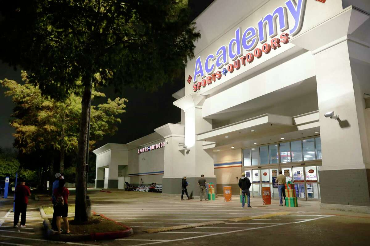 Customers wait outside for the store to open at 5am for Black Friday at the Academy Sports and Outdoor store at 7600 Westheimer Friday, Nov. 27, 2020 in Houston, TX.