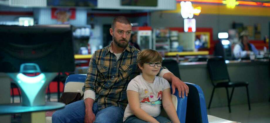 """This image released by Apple shows Justin Timberlake, left, and Ryder Allen in a scene from """"Palmer."""" (Apple via AP) Photo: Associated Press / Apple"""