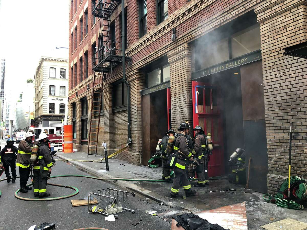 San Francisco firefighters control a fire that broke out at 111 Minna St. on Wednesday, Jan. 27, 2021.
