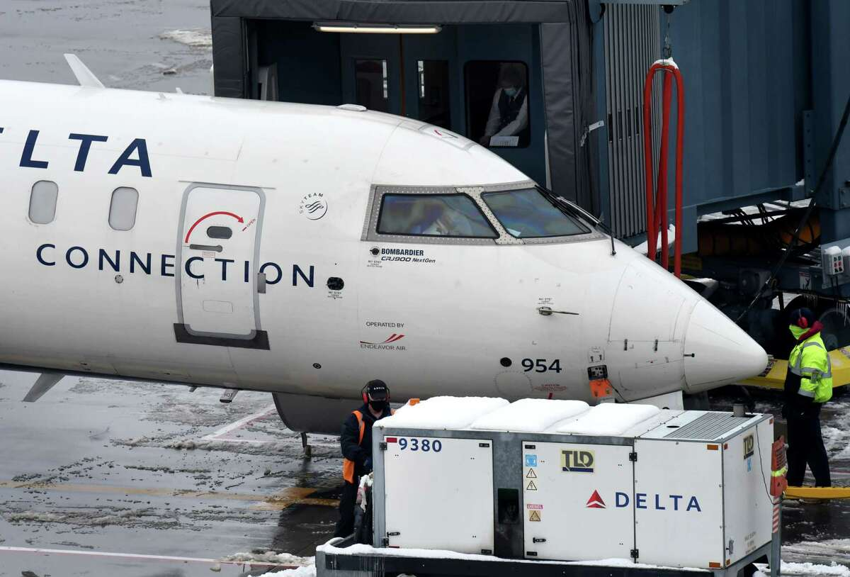 A Delta Airlines regional jet prepares for departure from Albany International Airport on Wednesday, Jan. 27, 2021, in Colonie, N.Y. (Will Waldron/Times Union)