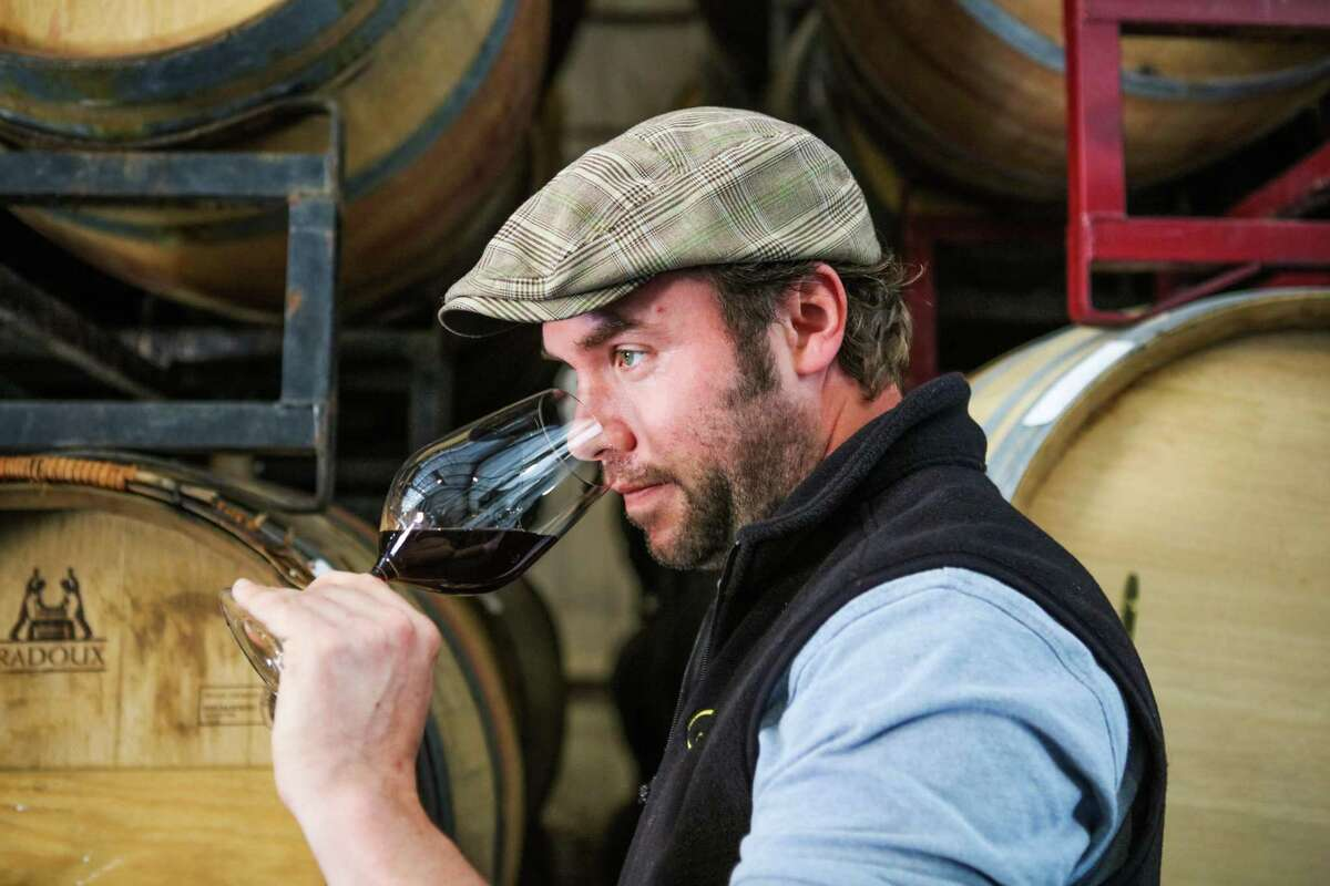 Jonathan Hajdu, the winemaker at Covenant Wines, a kosher winery, sniffs a glass of wine which came straight out of the barrel, in Berkeley, California.