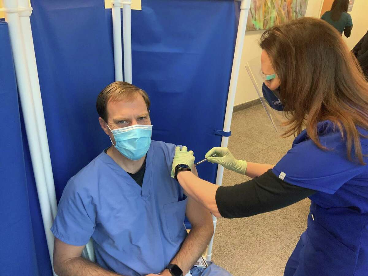 Getting enough COVID-19 vaccine allocation to Houstonians has been a daunting challenge for Harris County health officials. Featured image: The Woodlands Fire Department is receiving the COVID-19 vaccine at several locations, primarily at Memorial Hermann