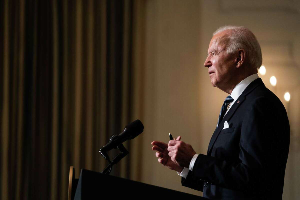U.S. President Joe Biden speaks in the State Dining Room of the White House in Washington, D.C., U.S., on Wednesday, Jan. 27, 2021. Bidendepicted his climate policies as an employment plan for the U.S., arguing that fighting warming global temperatures and carbon pollution by improving infrastructure and transportation technology will add millions of jobs. Photographer: Anna Moneymaker/The New York Times/Bloomberg