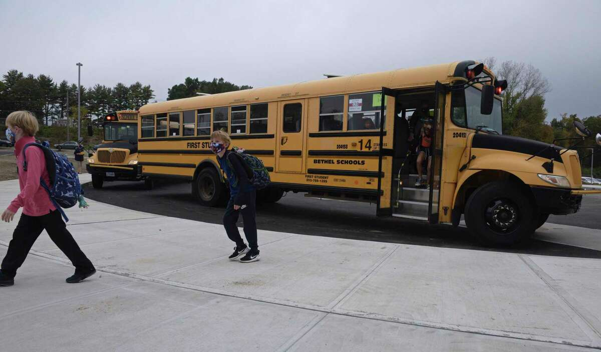 Students head into Ralph M. T. Johnson Elementary School in Bethel, Conn., for in-person learning Sept. 29, 2020.