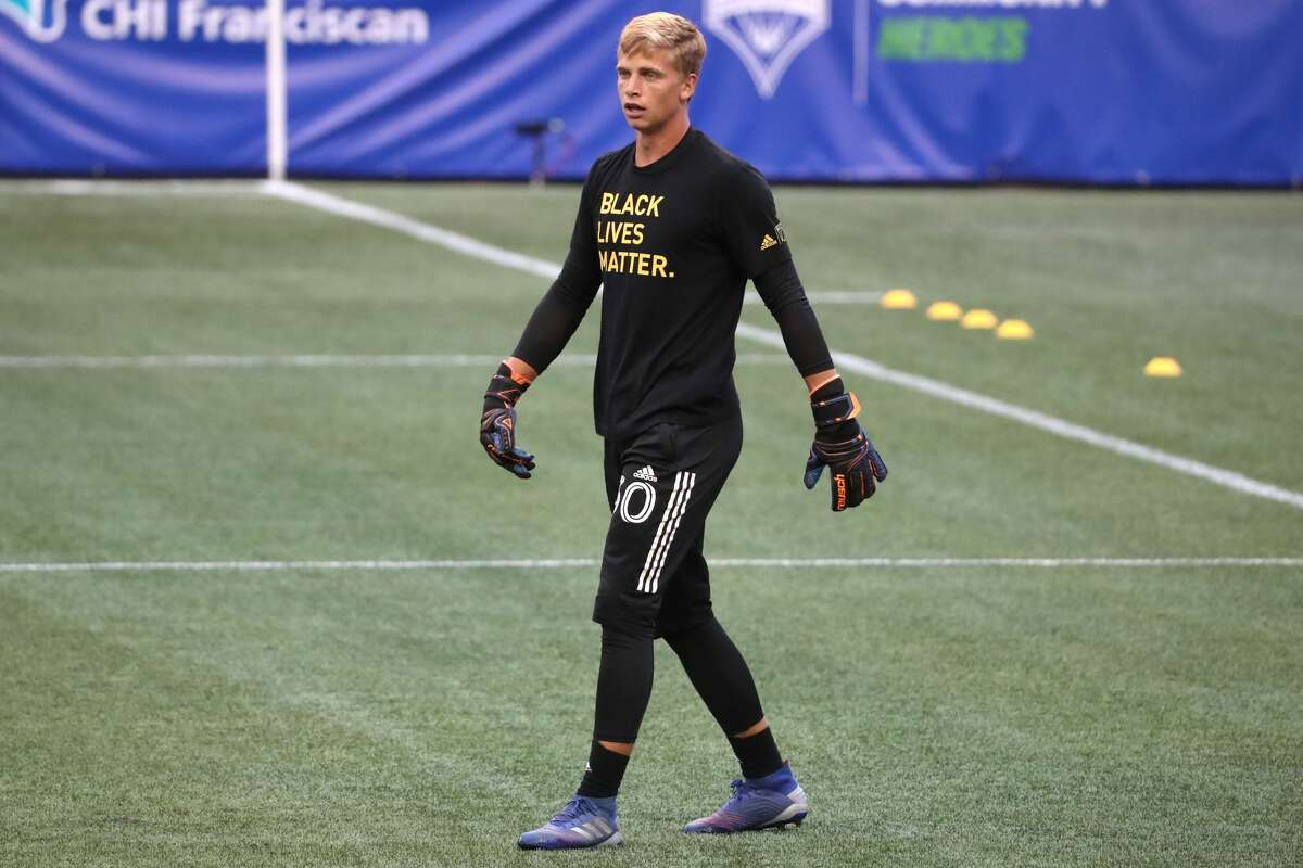 SEATTLE, WASHINGTON - AUGUST 30: Stefan Cleveland #30 of Seattle Sounders warms up while wearing a social justice shirt before their game against Los Angeles FC at CenturyLink Field on August 30, 2020 in Seattle, Washington. (Photo by Abbie Parr/Getty Images)