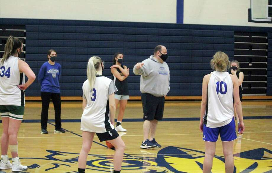 Morley Stanwood girls basketball coach Rob Brauher instructs his players during a recent practice. (Pioneer photo/John Raffel)