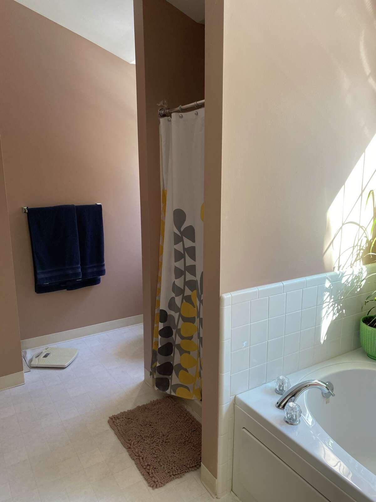 Interior designer Julie Maleski Putzel recommends Leigh Hornbeck replace the vinyl flooring with luxury vinyl plank.