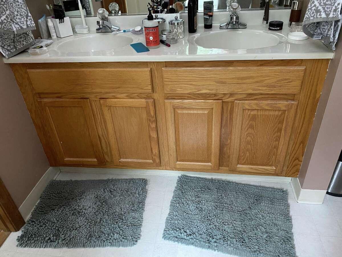 Interior designer Julie Maleski Putzel recommends Leigh Hornbeck get different hardware for her bathroom vanity and paint the cabinets.