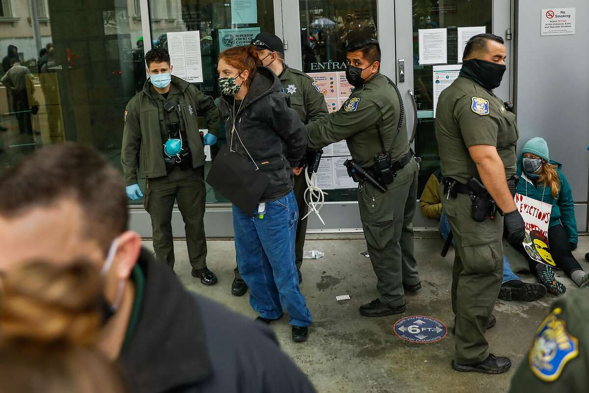 Sheriffs arrest a demonstrator who was blocking the door to the Santa Clara County Courthouse in San Jose in an attempt to halt eviction proceedings from taking place on Wednesday, Jan. 27, 2021 in San Jose, California.