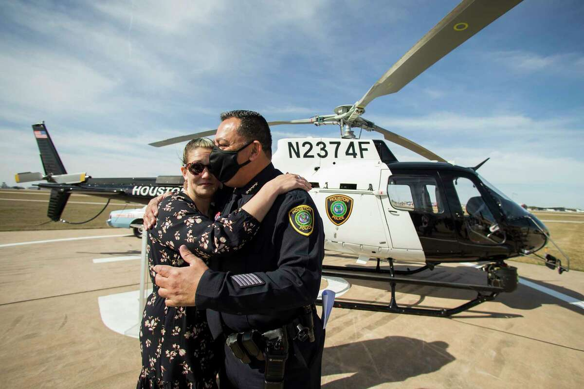 Houston Police Chief Art Acevedo embraces Keira Knox during the dedication ceremony for the department's newest helicopter to the memory of her husband, fallen Police Officer/Tactical Flight Officer Jason Knox, Wednesday, Jan. 27, 2021 in Houston. The H125 Airbus incorporates Officer Knox's badge number of 2374 into its registration number, which is N2374F. The fuselage also features a vintage HPD blue stripe as a nod to Knox's passion for the department's history. Knox was killed in the line of duty on May 2, 2020, when the HPD helicopter he was in crashed while on a call-for-service.