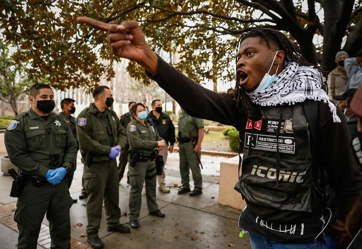 Demonstrator Lou Dimes yells at Sheriffs during a protest outside the Santa Clara County Courthouse in San Jose where protesters attempted to halt eviction proceedings from taking place on Wednesday, Jan. 27, 2021 in San Jose, California.