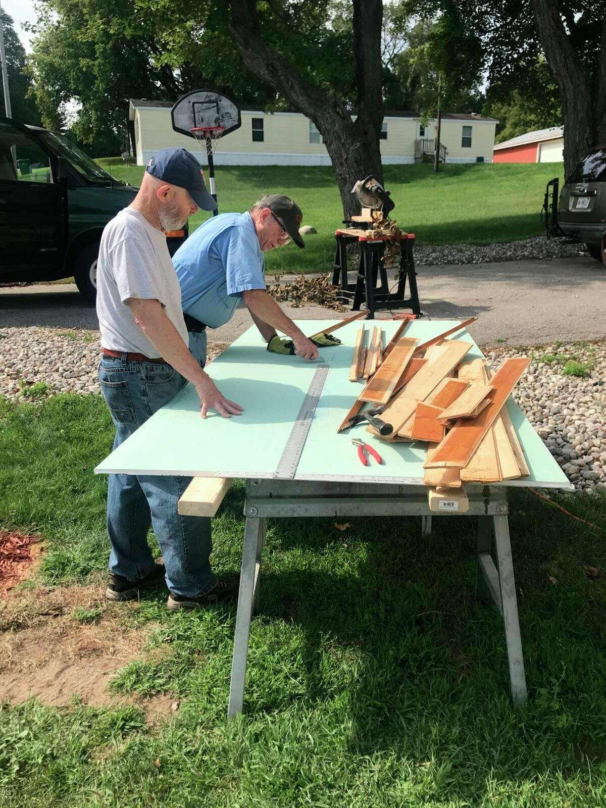 Two Habitat for Humanity volunteers get to work on a home repair project for a local veteran. Both volunteers are veterans as well. (Courtesy photo)