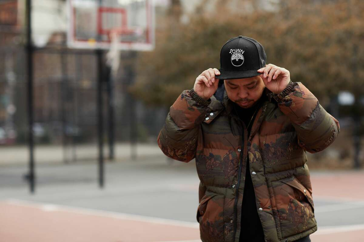 Designer and artist Dustin Canalin wearing a Golden State Warriors' The Town hat.