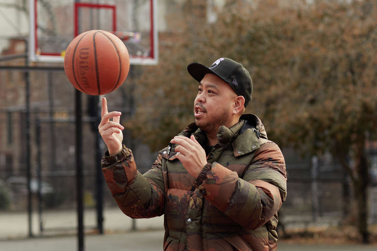 Dustin Canalin spins a basketball on his finger at a New York City park.
