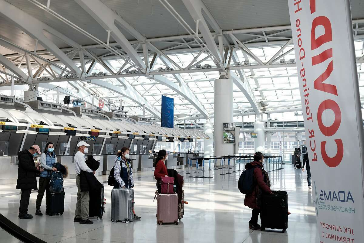 FILE: People wait for a flight at an international terminal at John F. Kennedy Airport (JFK) on January 25, 2021 in New York City.