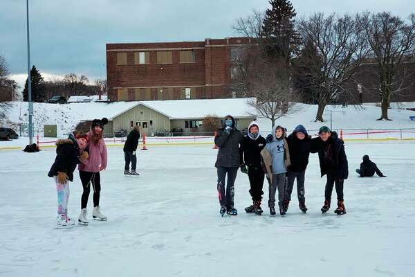 Local youth skate at the Sands Park ice rink in Manistee. The rink opened to skaters on Jan. 26. (Courtesy photo/Sheila Kaminski)