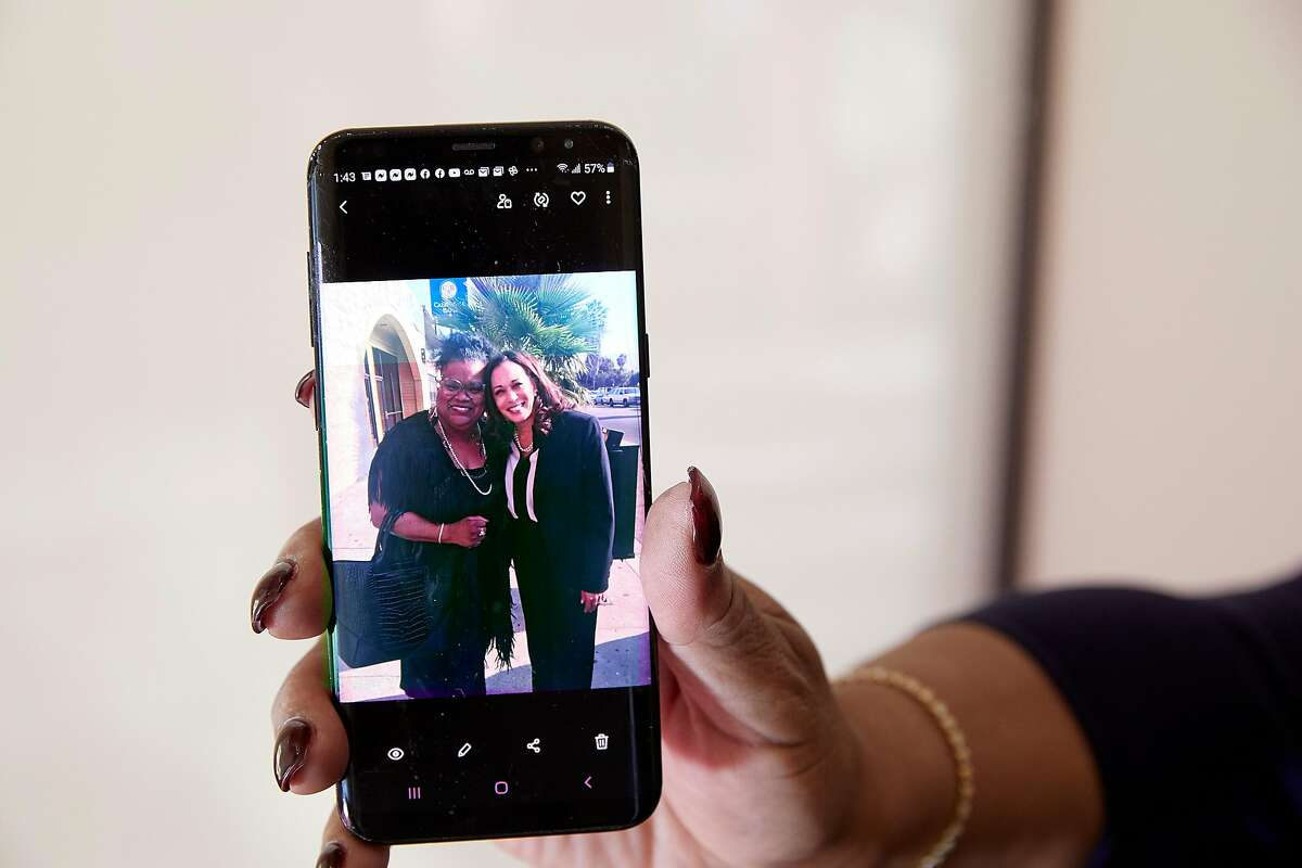 Sun-Reporter publisher Amelia Ashley-Ward shows a photo of herself with Vice President Kamala Harris. Ashley-Ward first threw her support behind Harris when Harris ran for district attorney of S.F., and the two have been close friends ever since.