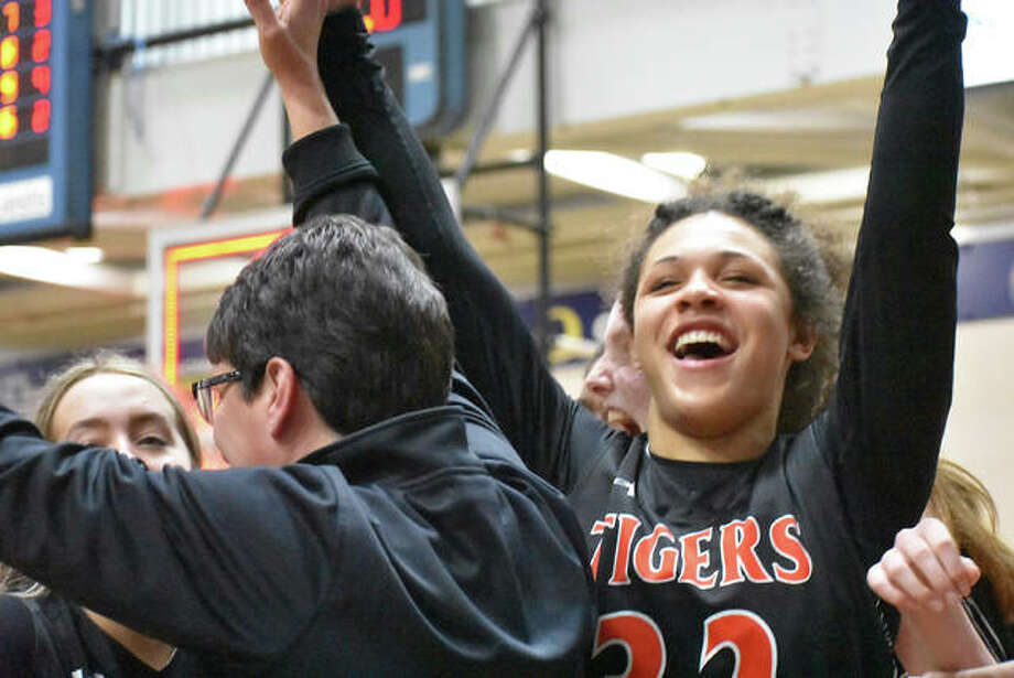 Edwardsville's Maria Smith, right, celebrates on the bench after an overtime victory against O'Fallon clinched the Southwestern Conference championship for the Tigers last season.