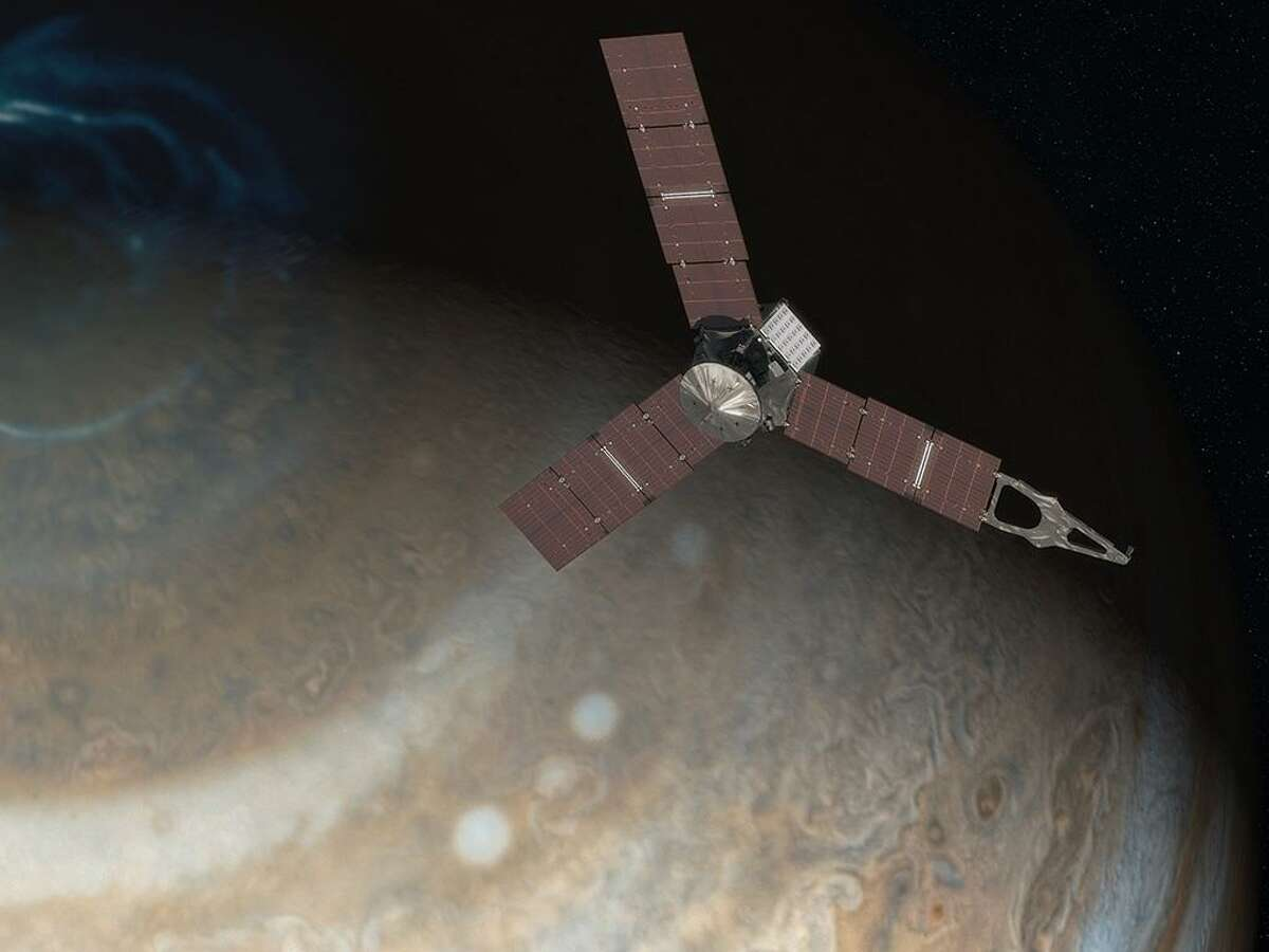 This artist's concept depicts NASA's Juno spacecraft above Jupiter's north pole.