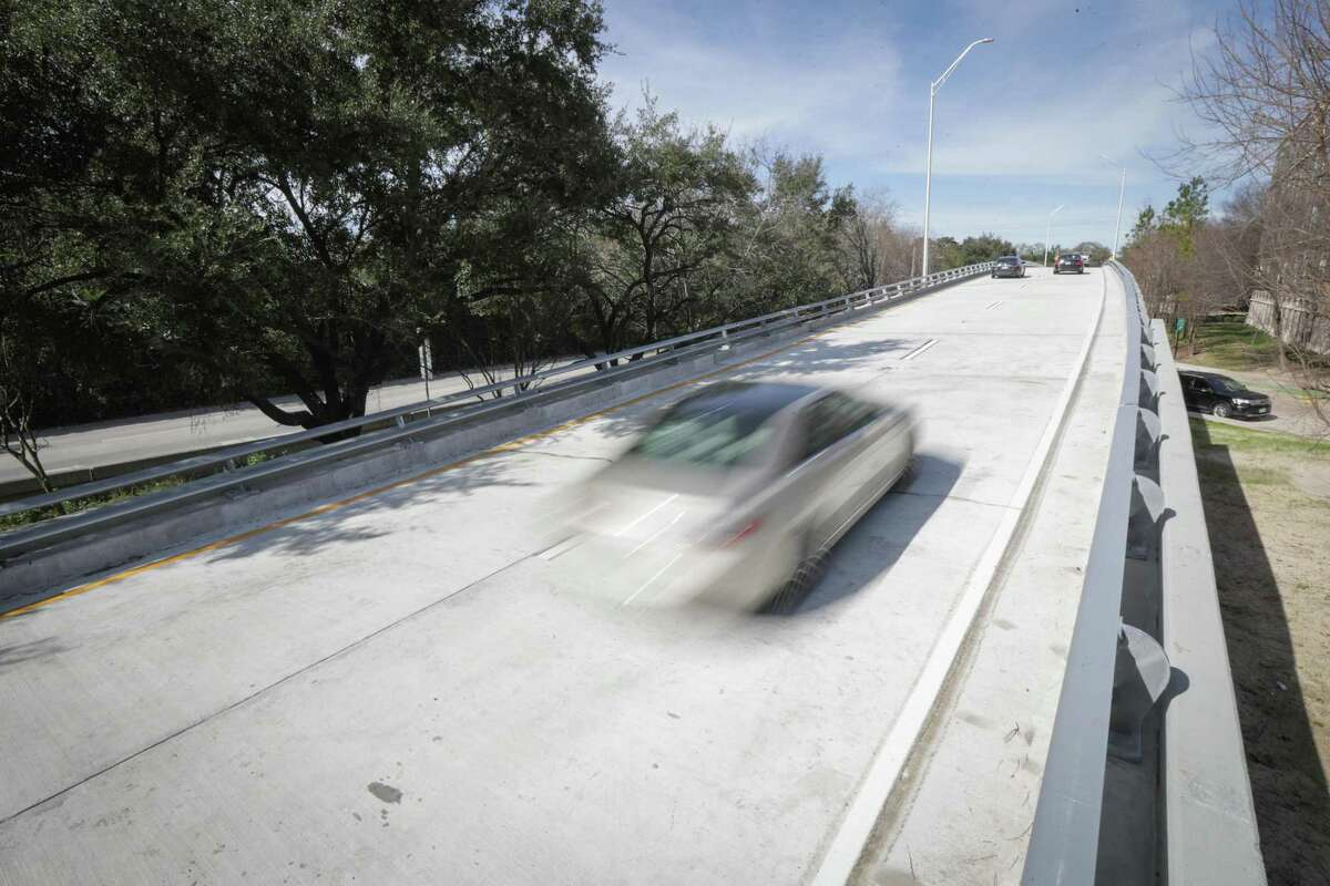 Vehicles pass along the Brazos Bridge on Spur 527 that runs over Smith and Holman streets in Midtown on Jan. 27, 2021, in Houston. A rebuild of the bridge, closed in July 2019, was completed two weeks ahead of schedule.
