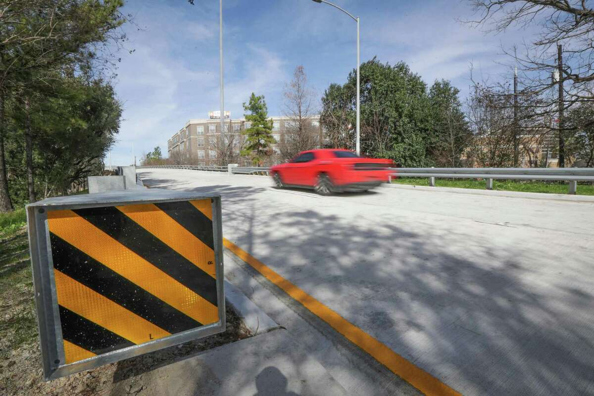 Vehicles pass along the Brazos Bridge on Spur 527 that runs over Smith and Holman streets in Midtown on Jan. 27, 2021, in Houston. The bridge closed in July 2019 and reopened earlier this week.