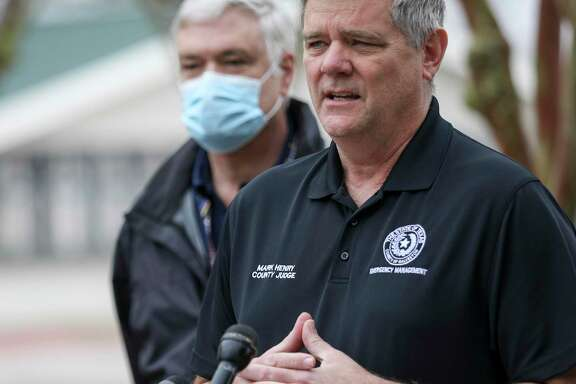 Galveston County Judge Mark Henry speaks during a press conference about mass vaccination efforts for Galveston County as Dr. Philip Keiser, the local health authority, listens Wednesday, Jan. 20, 2021, at Walter Hall Park in League City.