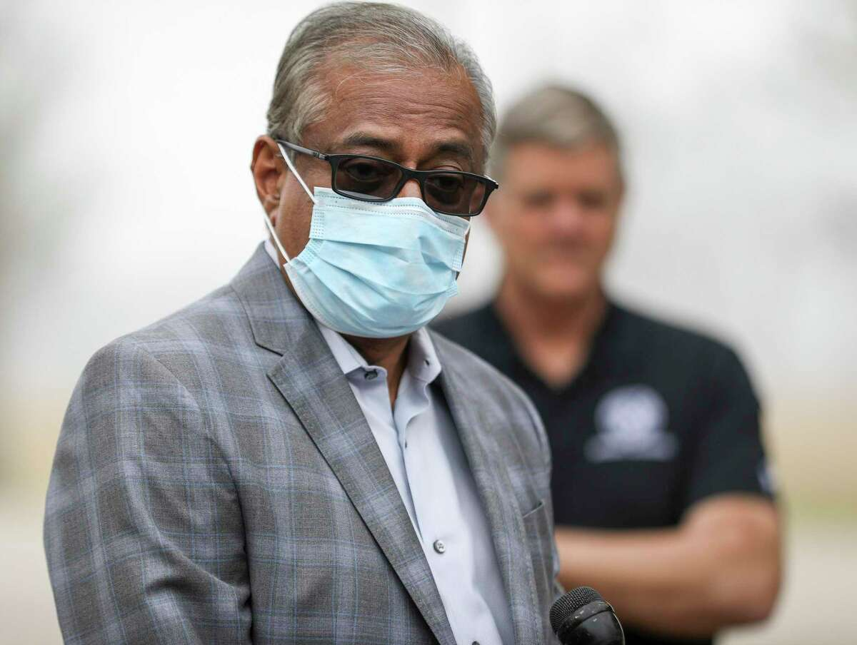 Dr. Janak Patel, co-chair of the Vaccine Preparedness Task Force, speaks during a press conference about mass vaccination efforts for Galveston County as Galveston County Judge Mark Henry listens Wednesday, Jan. 20, 2021, at Walter Hall Park in League City.